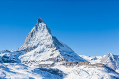 View of Matterhorn on a clear sunny day. On the winter hiking path, Zermatt, Switzerland royalty free stock image