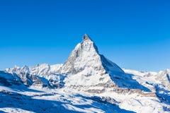 View of Matterhorn on a clear sunny day. On the winter hiking path, Zermatt, Switzerland stock photography