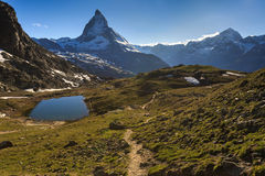View of Matterhorn Mountain with lake at Zermatt Royalty Free Stock Photography