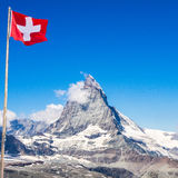 View of the Matterhorn - Zermatt, Switzerland. Matterhorn peak with Switzerland flag Stock Photos