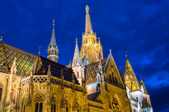 View of the Matthias Church during blue hour, roman catholic church located in Budapest, Hungary inside Fisherman`s Bastion at the Stock Photography