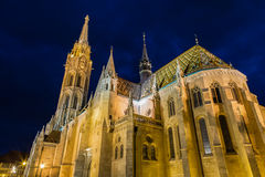 View of the Matthias Church during blue hour, roman catholic church located in Budapest, Hungary inside Fisherman`s Bastion at the Stock Image