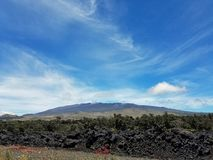View of Mauna Kea Mountain on a Partly Cloudy Day. Big Island, Hilo, Hawaii Stock Image