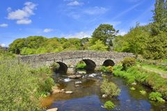 Picturesque Old Bridge of South West England. View in May of the picturesque old bridge over the East Dart river at Postbridge, Dartmoor Forest, Devon, England royalty free stock photography