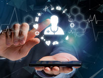 Medecine and general healthcare icon displayed on a technology i Stock Photos