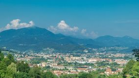 View of medieval Bergamo timelapse - beautiful medieval town in north Italy. Mountains on background. Panoramic top view. Blue cloudy sky at summer day stock footage