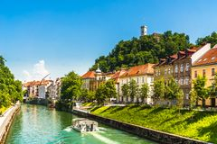 Medieval buildings and ljubljanica river in Ljubljana - Slovenia. View on medieval buildings and ljubljanica river in Ljubljana - Slovenia royalty free stock photo