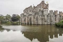 View of the medieval castle the Gravensteen Castle of the Counts surrounded by water stock image