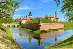 View on medieval castle Nesvizh, moat with water and fortress wa Royalty Free Stock Photo