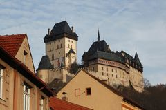 View of the medieval castle roof finials mountains and hills of the Czech Republic Prague. View tower Princess roof blue sky stone wall journey the types of Royalty Free Stock Photography