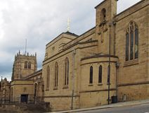 View of the medieval church of bradford cathedral in west yorkshire with main building and entrance from the street. A view of the medieval church of bradford royalty free stock image