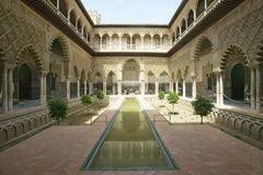 View of the Medieval garden and courtyard, the Patio de las Doncellas, of the Royal Palace, Sevilla, Spain, dating back to the 9th Stock Photo