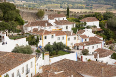 View of the medieval Portuguese village Obidos. View of the medieval Portuguese village of Obidos. There is a Castle wall with battlements in the background Royalty Free Stock Photos