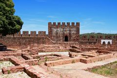 Medieval castle tower and ruins, Silves, Portugal. View of the Medieval ruins inside the castle with the battlements and one of the towers to the rear, Silves Royalty Free Stock Photo