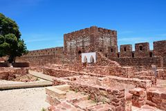 Castle tower and ruins, Silves, Portugal. View of the Medieval ruins inside the castle showing the vaulted Moorish windows of the palace of balconies with the Stock Photos