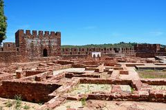 Medieval castle and ruins, Silves, Portugal. View of the Medieval ruins inside the castle showing the vaulted Moorish windows of the palace of balconies with Royalty Free Stock Photography