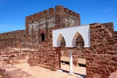 Palace of balconies inside Silves castle, Portugal. View of the Medieval ruins inside the castle showing the vaulted Moorish windows of the palace of balconies Stock Photography