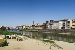 View of the medieval skyline of Florence with young people having a good time and watching the skyline royalty free stock photos