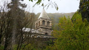 View on medieval stone building with tower under the rain. In the forest stock video
