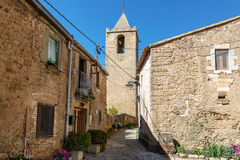 View of the medieval stone houses and bell tower. Village Sant-Esteve-de-Guialbes, Spain. Stock Photos