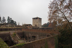 View of medieval tower and walls of Medici Fortress of Santa Barbara. Pistoia. Tuscany. Italy. Royalty Free Stock Photos