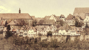 View of the medieval town beyond the pinion wall. Retro Style. View of the medieval town beyond the pinion wall. Rothenburg, Bavaria, Germany. Retro Style Stock Photography