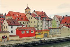 View of Danube river bank in Regensburg, Bavaria, Germany. stock photos