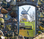 View on medieval windmill trough broken door of old building Royalty Free Stock Photos