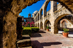 View of the Meditation Garden Through an Old Stone Arch at the Historic Old West Spanish Mission San Jose Stock Photo