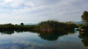 Mediterranean Rivers in Autumn 23. A view from a Mediterranean river and marshes around it. Shot in  Akyaka Gulf of Gokova, Aegean Sea, on an autumn day. A stock video