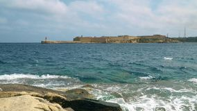 View of the Mediterranean Sea, Fort Ricasoli and the island of Malta from the coast of Valletta. View of the Mediterranean Sea, Fort Ricasoli and the island of stock footage