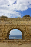 View of the Mediterranean Sea through a stone arch. Of the ancient Roman aqueduct , Caesarea, Israel Royalty Free Stock Photography