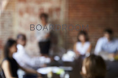 View Of Meeting Through Glass Door Labelled Boardroom Royalty Free Stock Image