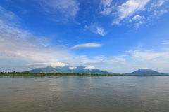 View of Mekong river with background of green mountain and blue Stock Image