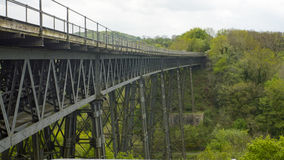 View of Meldon Viaduct. The Meldon Viaduct is a railway bridge built in 1871 to carry the London and South Western Railway across the West Okement River at Stock Photography