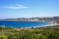 View of the Melleiha coastline, Malta. Elevated view of the beach, town and coastline, Mellieha, Malta, Europe Royalty Free Stock Photo