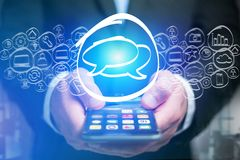 Message icon going out a smartphone interface - technology conce Royalty Free Stock Photo