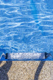 View of a metal ladder in the pool Royalty Free Stock Image