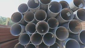 View through metal pipes of large diameter. Metal pipes of large diameter in a metal warehouse, large pipes in an open. Metal pipes of large diameter in a metal stock video