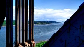 View of a metal structure and the shore of the St. Lawrence River. View of a metal structure of the Quebec Bridge in Canada and the shore of the St. Lawrence stock photos