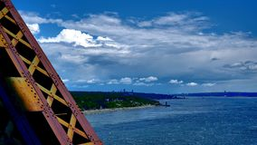 View of a metal structure and the shore of the St. Lawrence River. View of a metal structure of the Quebec Bridge in Canada and the shore of the St. Lawrence royalty free stock photography