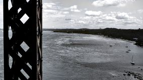 View of a metal structure and the shore of the St. Lawrence River. View of a metal structure of the Quebec Bridge in Canada and the shore of the St. Lawrence stock image