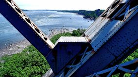 View of a metal structure and the shore of the St. Lawrence River. View of a metal structure of the Quebec Bridge in Canada and the shore of the St. Lawrence royalty free stock photo