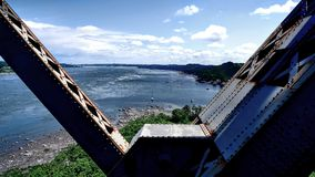 View of a metal structure and the shore of the St. Lawrence River. View of a metal structure of the Quebec Bridge in Canada and the shore of the St. Lawrence stock photography
