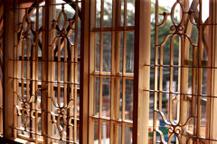 View through metal window grill. Looking through metal window grill Stock Image