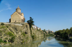 View of the Metekhis Cathedral above Kura river in Tbilisi city center, Georgia Royalty Free Stock Photography