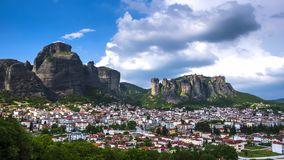 View of Meteora rocks and Trikala villages at daytime in sunshine and great clouds fly over - timelapse. View of Meteora rocks and Kalambaka and Kastraki village stock video