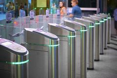 View on metro station ticket barriers with green light for entry. Moscow metro station. Station entrance tourniquet green light to stock photography