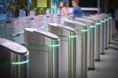 View on metro station ticket barriers with green light for entry. Moscow metro station. Station entrance tourniquet green light. To enter to run. New modern royalty free stock photo