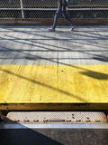 View from the metro train to subway platform with yellow marking line and walking people Stock Image